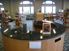 I like the round circulation desk - have a couple of these around the place rather than one big circulation desk.