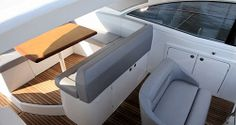 Beneteau Gran Turismo 44: Both the table and the helm area are on raised platforms for improved sightlines through the many windows surrounding the cockpit. We like the double-wide companion seat on the centerline which means as many as three people can be facing forward while underway.
