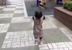 Little Korean girl can't stay mad at dad