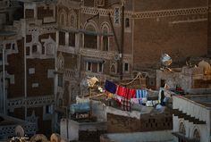 https://flic.kr/p/59uJB4 | laundry day - Sana'a, Yemen | The old city of Sana'a, a UNESCO World Heritage Site, has a distinctive visual character due its unique architectural characteristics, most notably expressed in its multi-storey buildings decorated with geometric patterns