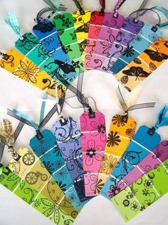 Paint chip bookmarks. Hole punch a hole at the top then tie ribbon through, next draw designs with black thin tipped marker.