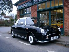 """Nissan Figaro, made in 1991 as a """"retro"""" modern car for Japan.   Only in red and black please"""