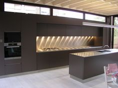 Stainless steel island worktop with bonded sink and bench worktop, with pop-up power socket and separate splashback