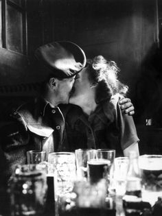 U.K. A couple in a pub, somewhere in London, 8th May 1945 // Photo by Popperfoto/Getty Images