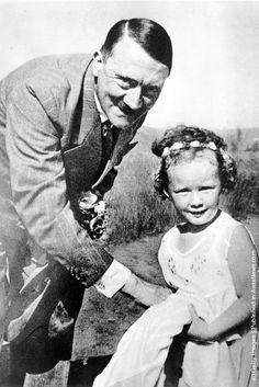 Adolf Hitler with a little girl [1935] I'm pretty sure he's trying to steal candy from her.