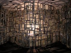 Einsame Zelle (Solitary Cell) - 2006 Berlin, GER. Artist Chiharu Shiota.  Inside is a single chair and a naked light bulb.