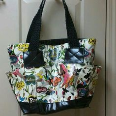 SAK tote SAK tote. This tote has been carried and loved. It has color transfer from the black handles. 11.5 inches across by 13 inches tall and 8 inches deep not including straps. Sak Bags Totes