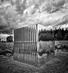 Stainless Steel Cube Sculpture in Kielder Forest, Northumberland, UK.