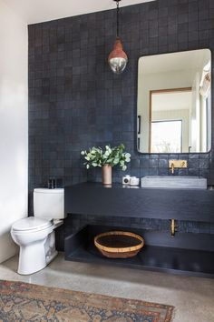 Navy Blue Tile wall black wood vanity brass faucets