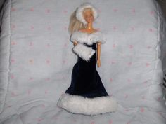 Blue Velour Gown with White Fur Hem and Bodice Hat and Muff included fits Barbieand most Fashion Dolls http://www.bonanza.com/listings/Blue-Velour-Gown-with-White-Fur-Hem-and-Bodice-Hat-and-Muff-included-fits-Barbie/42294944