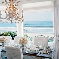 Seashell Chandelier makes this beach cottage room divine #exteriordesign #seashellchandelier