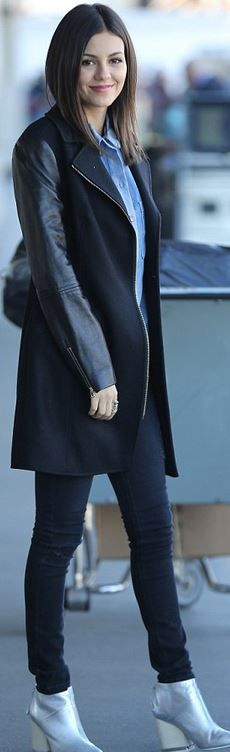 Who made Victoria Justice's black leather coat and silver boots?