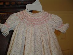 Baby Bishop pattern from Chery Williams.  Smocking plate is Cary Anne by Ellen McCarn.  Peach/pink floral from Fabric Finders