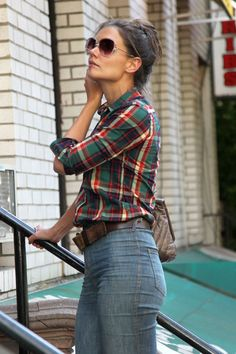 Katie Holmes, wearing a plaid button up and high waisted jeans, heads out to a Brazilian restaurant in New York City. Katie was spotted earl...