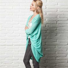 """Get comfy with this round hem, batwing, slouchy oversized cardigan. Made with soft fabric that's breathable, lightweight and so comfortable that you willmake this your all-season outerwear.55% Polyester, 45% Rayon.Body length: 37"""" long (size Medium). Model is wearing a Small, she is 5'8, dress size is 4.Wash cold with like colors, do not bleach, hang or line dry.Made in USA."""