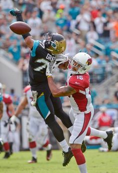 Jacksonville Jaguars cornerback Dwayne Gratz, left, breaks up a pass intended for Arizona Cardinals wide receiver Michael Floyd (15). (Phelan M. Ebenhack/AP)