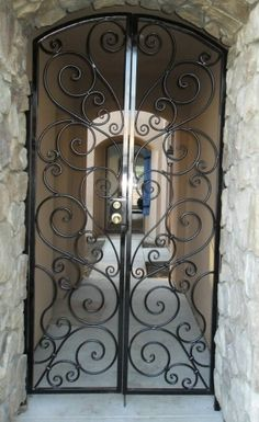 Wrought Iron Gate something similar as door for arch in dining? Hmmm