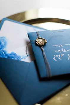 Indigo and Gold Wedding Invitation with a Wax Seal | Heather Mills Photography | http://heyweddinglady.com/elegant-watercolor-wedding-shoot-bold-cobalt-blue/