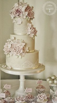 Vintage chic style wedding cake with roses from Cotton and Crumbs.