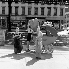 Vivian Maier. She wandered the streets of New York and, mostly using her Rolleiflex twin-lens reflex camera, snapped pictures wherever she went. 1951-1956.