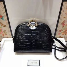 Gucci Ophidia Crocodile Pattern Small Shoulder Bag 499621 cmCrafted in crocodile skins with a glossy sheen, the shoulder bag has a domed shape that recalls vintage designs. The Double G—an archival code—appears atop a leather tab d Gucci Shoulder Bag, Small Shoulder Bag, Gucci Handbags Sale, Gucci 2018, Designer Bags For Less, Crocodile Skin, Crossbody Bag, Tote Bag, Bag Sale