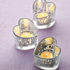 These are pretty little tealight holders. Why not make Valentine's Day every day. Order your Warm Hearts Tealight Holders now.  www.partylite.biz/carolparlee