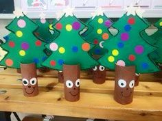 Decorate a card tree and slot into half a toilet roll tube