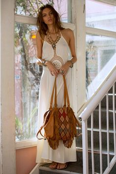 Crochet embellished midriff boho chic maxi dress and modern hippie fringe purse for an elegant gypsy allure.  For the BEST Bohemian fashion trends FOLLOW>> https://www.pinterest.com/happygolicky/the-best-boho-chic-fashion-bohemian-jewelry-gypsy-/<< now.