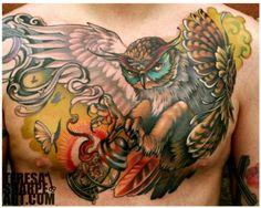 owl tattoo on chest http://blog.tattoodo.com/2014/03/25-beautiful-owl-tattoos/