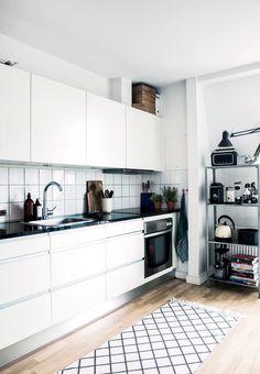 Ikea 'Hyllis' metallic shelf in oranized kitchen