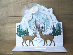 Christmas card by DT member Astrid with Creatable Petra's Circle and Crown (LR0317), Craftables Tiny's Pinetrees (CR1287) and Tiny's Deer (CR1289) by Marianne Design