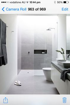 White and grey bathroom with concrete bench tops