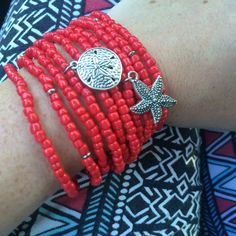 Combo bracelets! Sand dollar and starfish bracelet sets stack well together for a colorful, beachy touch!