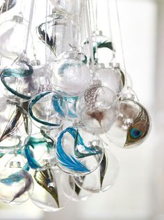 feathers inside clear glass ornaments
