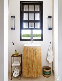 Powder rooms -- In the powder room of designer Tom Scheerer's getaway in the Bahamas, RH sconces are installed above a Duravit sink with Grohe fittings; a grass skirt hides the pipes. [What a sillly, great idea]] Toms, Bahamas Vacation, British Colonial Style, Best Interior Design, Architectural Digest, Beautiful Interiors, Room Inspiration, Home Furniture, Houses