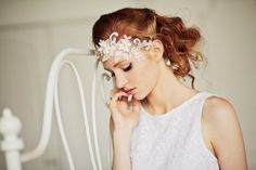 messy bridal updo with floral lace headpiece
