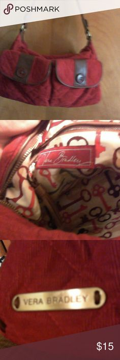 Vera Bradley Red Quilted Corduroy Shoulder Bag Cute little red bag with brown leather trim, tassels on outside and inside zipper pulls, button embellishments.  Cute key material inside Vera Bradley Bags