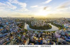 HOCHIMINH CITY, VIETNAM - JULY Sunset on the Saigon river and city center on riverbank in Hochiminh city, Vietnam on July Hochiminh city is the biggest city and economic center in Vietnam. Vietnam, Dolores Park, Asia, River, Stock Photos, Sunset, City, Rivers, Cities