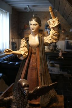 mid 19th Century religious caged Belgian Santos in sculpted wood. She has flexible wooden joints at the arms, original paint and important detail with the original embroidery clothes, Belgium, 19th c