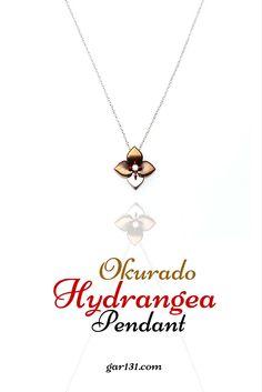 Okurado Hydrangea Pendant by Hitoshi Okura, Japanese Jeweler. Composed of Hydrangea Urushi and Makie Pendant. Materials are 18 ct white gold 2,83 gram 0,08 ct diamonds