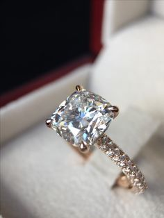 A rare 3.00ct Cushion Cut Diamond. The ring is 18ct Rose gold made by hand with pave' set diamonds in the shoulder.