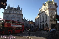 Piccadilly Circus with a typical red bus on a blue sky day - London, UK, Great Britain