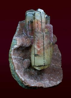 Superb specimen of amethyst geode with pink-green calcite inside From Brazil