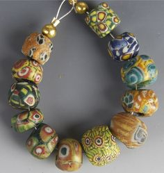 Group of 12 little ancient beads.  The largest is only a little more than 12 mm in diameter.  Just amazing!