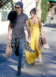 Take my lead: A grungy looking Austin walked two paces ahead of his Broadway bound girlfri...