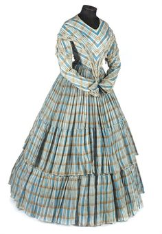 Day Dress: ca. 1840's, cotton check, dropped shoulders and deep pointed bodice embellished with silk fringe, full skirts tiered.