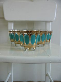 Glassware Juice Cup Shot Glass Bar Mid Century Retro Aqua Gold Vintage. $26.00, via Etsy.