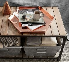 Slatted wood shelves and riveted corner braces enhance the Turlock Coffee Table's rustic industrial character. Add our Galvanized Nesting Bins (sold separately) for more organization options; they're designed and styled to fit perfectly and look great.