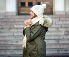Cold weather outfit. Green parka, cream colored knit beenie, and matching cream scarf. | mariannan