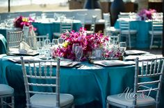 Turquoise, silver & Fuchsia at Cabo Azul Resort by www.linensthingsandmore.com and flowers by Cabo Floral Studios!